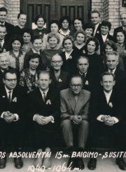 Panevėžio mokytojų seminarijos V-os laidos (1949 m.) absolventai 15 m. baigimo-susitikimo proga. 2-oje eilėje iš kairės sėdi pedagogai: Domas Pinigis, Jonas Dičius, Mykolas Karka, Emilija Juzulėnienė, Jurgis Chrolavičius, Vladas Kukuraitis, Motiejus Lukšys, Kazimieras Bagdonas, Augustinas Juzulėnas. Panevėžys. 1964 m. PAVB F116-77