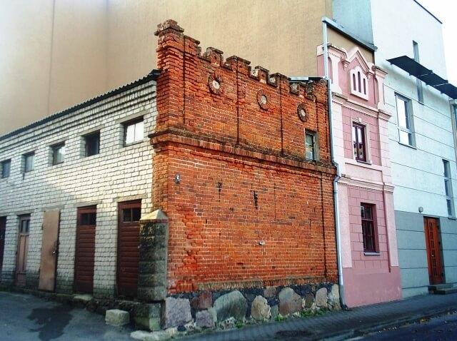 """Panevėžio Bataliono gatvėje išlikusi namo Nr. 5, kuriame veikė """"Vilnies"""" spaustuvė, siena"""